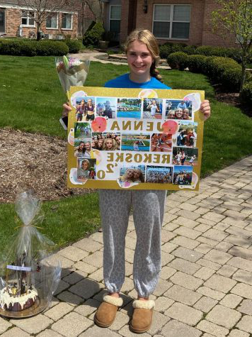Jenna Rekoske poses with her gifts from the track and field team. The team  surprised her to celebrate Senior Day.